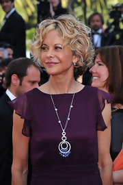 Meg Ryan showed off her classic style while hitting the red carpet in Cannes. Her silver pendant shined on the red carpet.