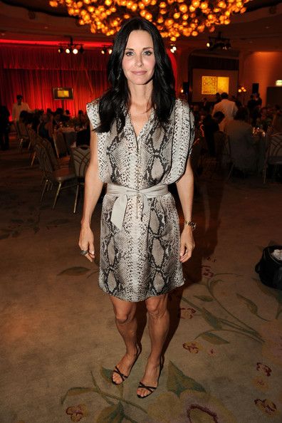 Courteney Cox Print Dress [fashion model,flooring,fashion,dress,girl,leg,carpet,little black dress,catwalk,trunk,beverly hills hotel,california,critics choice television awards,show,courteney cox]