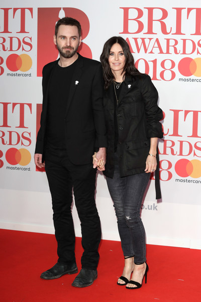 Courteney Cox Utility Jacket [carpet,red carpet,premiere,event,flooring,formal wear,red carpet arrivals,johnny mcdaid,courteney cox,brit awards,relation,the o2 arena,england,london,l]