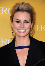 Niki Taylor added a sultry touch to her look with defined lashes that gave her s stand out look.