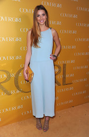 Whitney Port carrying a glimmering gold clutch. The metallic bag popped against her aqua evening dress.