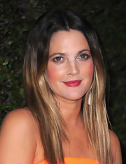 Drew Barrymore added a pop of color to her look with gleaming pink lip gloss. The perfect shade for the CoverGirl.