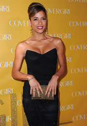 Dania Ramirez kept her polish neutral at CoverGirl's 50th Anniversary party. The beauty paired her gray polish with bright red lips.