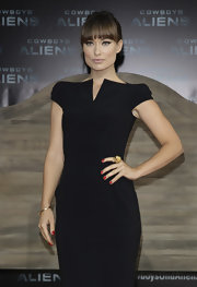 Olivia donned a sexy Tom Ford LBD for the Germany premiere of 'Cowboys and Aliens.' She paired the black ensemble with gold accessories, including a gold bracelet.