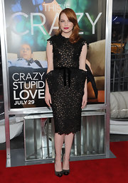 Emma Stone wowed at the Crazy Stupid Love premiere in an avant-garde dress teamed with eye catching Metalipp pumps. The gray suede Christian Louboutin pumps owe their unforgettable look to metallic cap-toes and sharply spiked heels.