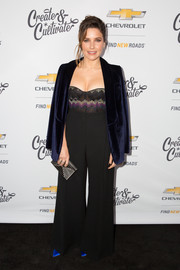 Sophia Bush added a bit of shine with a Lee Savage Cross Stack clutch, in silver.