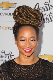 Monique Coleman wore her dreadlocks piled on top of her head in a bun at the Create & Cultivate 100 event.