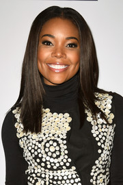Gabrielle Union was neatly coiffed with sleek straight layers at the Creative Coalition Spotlight Initiative Awards.
