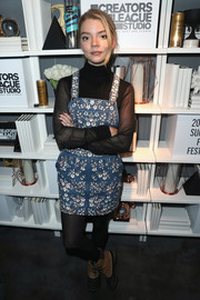 Anya Taylor-Joy teamed her cute outfit with a pair of two-tone snow boots by Sorel.