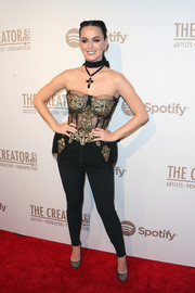 Katy Perry teamed her seductive top with black skinny pants.