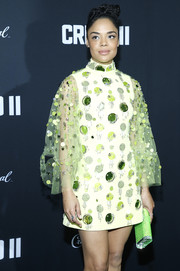 Tessa Thompson attended the New York premiere of 'Creed II' carrying a neon-green clutch by Judith Leiber.