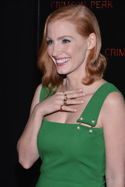 Jessica Chastain attended the New York premiere of 'Crimson Peak' wearing a Piaget gold ring on every finger.