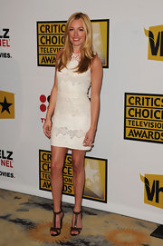 Cat Deeley gave her white lace dress an earthy finish with brown leather T-strap sandals with chunky wooden heels.