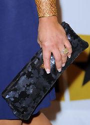 Adrienne Maloof carried a stylish black sequined clutch by Prada at the Critics' Choice Television Awards.