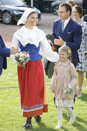Princess Victoria wore traditional Swedish garb, consisting of a blue vest layered over a long-sleeve white shirt, during her 40th birthday celebration in Borgholm.