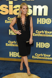 Cheryl Hines paired her dress with chic gold cap-toe pumps.