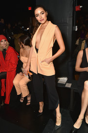 Olivia Culpo took a super-sexy plunge in an orange Cushnie Et Ochs vest that she wore sans shirt during the label's fashion show. The model also paired her look with Randall Scott Fine Jewelry earrings for a finishing touch.