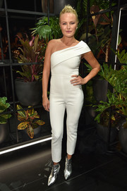 Malin Akerman styled her look with a pair of silver ankle boots.
