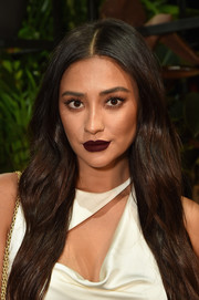 Shay Mitchell went for a bold beauty look with dark red lipstick.