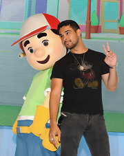 Wilmer Valderrama pulled off a kid-inspired Mickey Mouse tee at the D23 Expo.