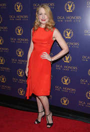 Patricia Clarkson chose a bright red dress with draped detailing for her DGA Honors look.