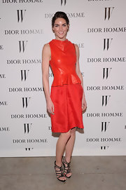 Hilary was a vibrant beauty in her orange dress with a leather bodice at the Dior Homme soiree.