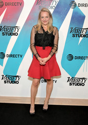 Elisabeth Moss paired her top with a flared red mini skirt.