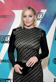 Abbie Cornish paired a geometric clutch by Emm Kuo with a textured black dress for her visit to DIRECTV House.