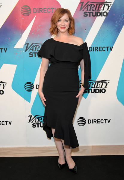 Christina Hendricks cut a curvy figure in a body-con off-the-shoulder LBD while visiting DIRECTV House.