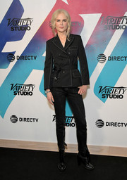 Nicole Kidman went menswear-chic in a belted black pantsuit by Chloe at the DIRECTV House.