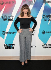 Linda Cardellini paired her top with gray wide-leg pants.