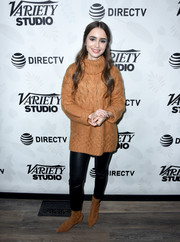 Lily Collins matched her sweater with a pair of pointy suede boots.