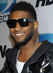 Usher never disappointments in the style department. The R&B crooner amped up his look with cool rectangle shades.