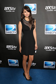 Nina Dobrev went for a seductive look in this black dress with a revealing lace decolletage.