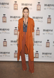 Underneath her coat, Olivia Palermo wore a pair of brick-colored wide-leg pants by MAX&Co.