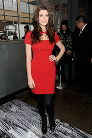 Ashley Greene topped off her little red dress with black tights and black leather ankle boots.