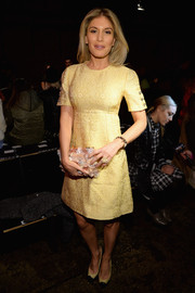 Hofit Golan went the demure route in an embroidered yellow cocktail dress during the DKNY fashion show.