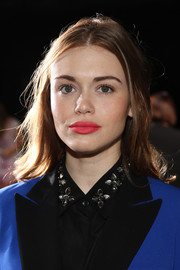 Holland Roden accentuated her pouty kissers with bright pink lipstick when she attended the DKNY fashion show.