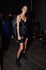 Martha Hunt rocked a skimpy black slip dress at the DKNY fashion show.