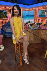 Miranda Cosgrove kept it breezy in a yellow and white halter dress by Lisa Perry at the DM3 Press Day Miami.