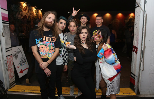 More Pics of Hailee Steinfeld Skinny Jeans (1 of 5) - Jeans Lookbook - StyleBistro [social group,event,fun,party,performance,crowd,night,art,t-shirt,leisure,dnce,party,jingle ball,dnce jingle ball,jack lawless,joe jonas,hailee steinfeld,luke hemmings,charlie walk,calum hood]
