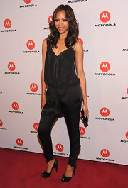 Zoe Saldana rocked a silky black v-neck camisole at the launch of Droid Razr.
