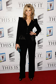Delta Goodrem cut a strong silhouette in a black pantsuit with pointy shoulders at the 'This is It' DVD launch and tribute party.