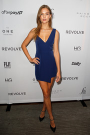 Black pumps with bedazzled ankle straps finished off Josephine Skriver's look.
