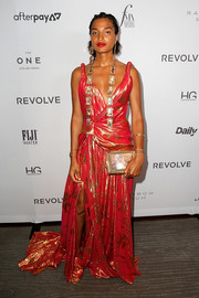 Indya Moore attended the 2019 Fashion Media Awards wearing a flowing red jacquard gown by Oscar de la Renta.