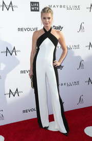 Rebecca Romijn went for casual sophistication in a black-and-white Edition by Georges Chakra halter jumpsuit at the Fashion Los Angeles Awards.
