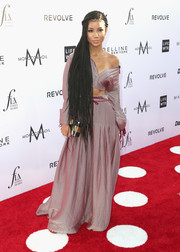 Jhene Aiko attended the Fashion Los Angeles Awards wearing a long-sleeve mauve crop-top by Hellessy.