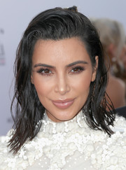 Kim Kardashian went for wet-look, messy waves when she attended the Fashion Los Angeles Awards.