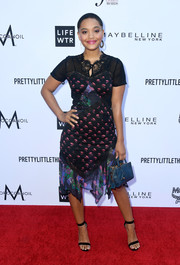 Kiersey Clemons opted for a mixed-print, handkerchief-hem dress by Coach when she attended the 2018 Fashion Los Angeles Awards.