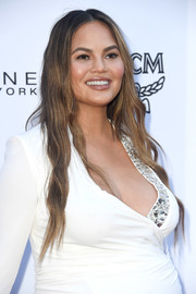 Chrissy Teigen went hippie-glam with these long, center-parted waves at the 2018 Fashion Los Angeles Awards.